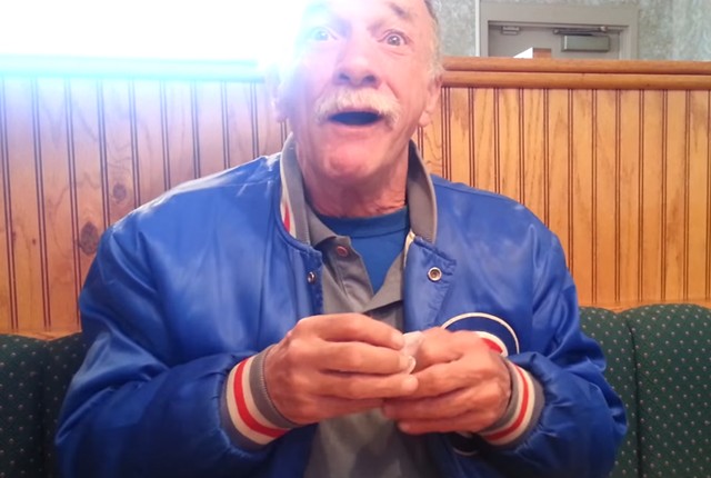 Surprised grandfather being told his daughter is pregnant