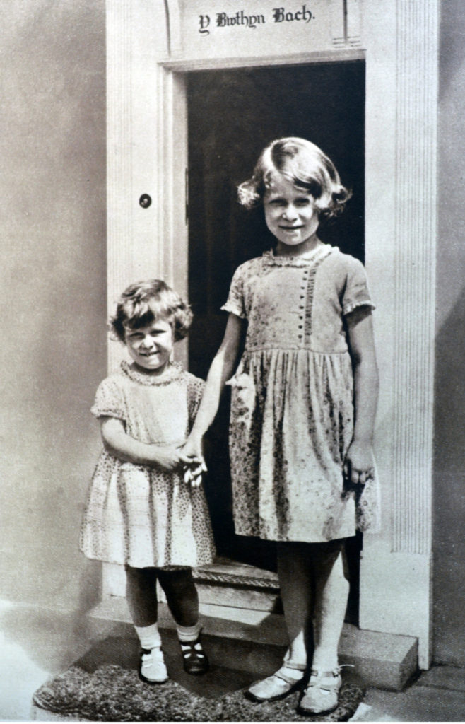 Mandatory Credit: Photo by Universal History Archive/REX/Shutterstock (4430197a) Princess Elizabeth (later Queen Elizabeth II) together with her sister Margret, stand at the door of their miniature cottage (a gift from the people of Wales). VARIOUS