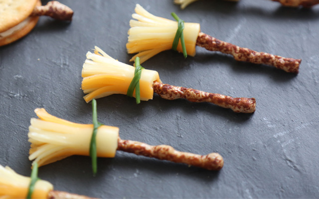 Halloween treat - cheese string and twiglet broomsticks